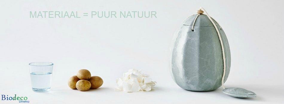 De zee-urn Beyond getoond met aardappelen, water en maiszetmeel. De natuurlijke producten waar de water-urn van gemaakt is
